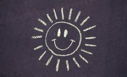 Drawing of happy smiling sun on concrete background Royalty Free Stock Photo