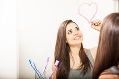 Drawing a heart in the bathroom mirror Royalty Free Stock Images