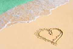 Drawing heart on beach Stock Images