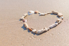 Drawing a heart on the beach Stock Image