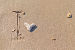 Drawing a heart on the beach Royalty Free Stock Photos