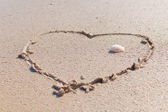 Drawing a heart on the beach Stock Photo