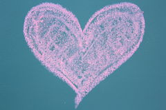 Drawing of heart icon. On black board Stock Image