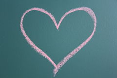 Drawing of heart icon. On black board Stock Images