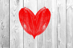 Drawing heart love symbol on white wooden wall Royalty Free Stock Photos