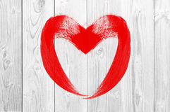 Drawing heart love symbol on white wooden wall Royalty Free Stock Images