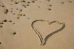 Drawing of a heart on sandy Stock Image