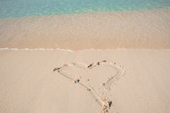 Drawing a heart on the shore of the beach Royalty Free Stock Photo