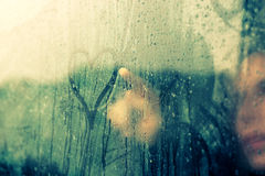 Drawing heart on wet window Stock Photography