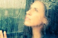 Drawing heart on wet window Stock Image