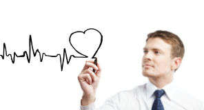 Drawing heartbeat. Young businessman drawing chart heartbeat Royalty Free Stock Photos