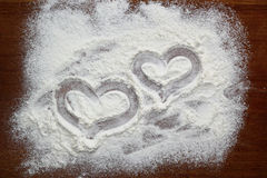Drawing hearts in flour Stock Photo