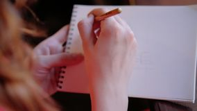 Drawing hobby unrecognizable woman sketching. Drawing hobby. Unrecognizable woman sketching in her notepad stock video