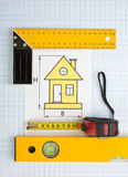 Drawing at home with construction tools Stock Photo