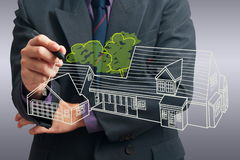 Drawing house. Architect drawing house on screen Stock Images