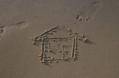 Drawing of a house on the beach Stock Photo