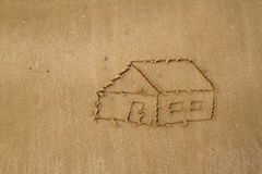 Drawing a house on the beach Royalty Free Stock Photography