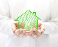 Drawing house in hands Royalty Free Stock Image