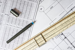 Drawing house plan, slide rule and pencil on the table Royalty Free Stock Photo