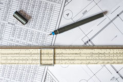 Drawing house plan, slide rule and pencil on the table Stock Photos
