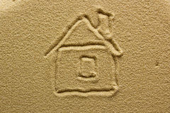 Drawing of a house on the sand Stock Photo