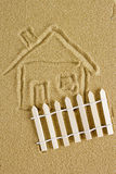 Drawing of a house on the sand Stock Image