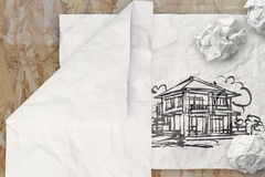 Drawing house on wrinkled paper Royalty Free Stock Photos