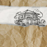 Drawing house on wrinkled paper Royalty Free Stock Images