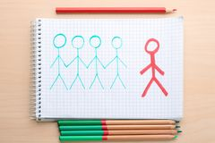 Drawing with human figures in notebook Royalty Free Stock Image