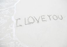 Drawing  I Love you  on beach - love concept Royalty Free Stock Image