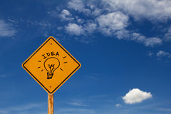 Drawing of Idea icon on yellow traffic sign Stock Image