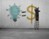 Drawing idea is money concept on wall Royalty Free Stock Photo