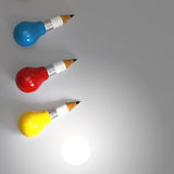 Drawing idea pencil and light bulb concept Royalty Free Stock Images