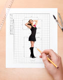 Drawing ideal girl. Concept image with male hand writing sizes of ideal girl stock photos