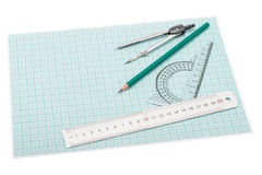 Drawing instruments lying on plotting paper Royalty Free Stock Image