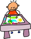Drawing kid. Little boy sitting at a desk drawing a picture with crayons - toddler art series Royalty Free Stock Images