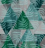 Drawing of the leaves of the fern. In green, dark green and gray colors a seamless pattern on a geometric shapes background Stock Photography