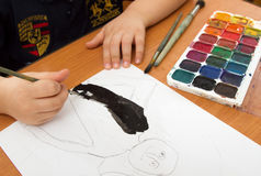 Drawing lesson in kindergarten. Paints, pencils and paper for the education of children drawing on the table royalty free stock photo