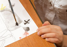 Drawing lesson in kindergarten. Paints, pencils and paper for the education of children drawing on the table royalty free stock photos