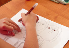 Drawing lesson in kindergarten. Paints, pencils and paper for the education of children drawing on the table stock photos