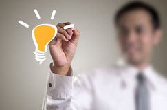 Drawing light bulb Royalty Free Stock Photography