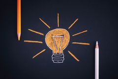 Drawing of a light bulb and colored pencils Stock Photos