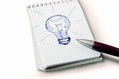 Drawing light bulb with pen Stock Photos