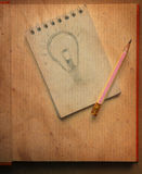 Drawing light bulb by pencil on recycle papaer Stock Photos