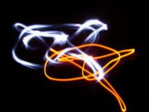Drawing lights. Drawing in the air made by flashlight royalty free stock photos