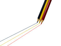 Drawing a line. Three colored pencils in blue, yellow and red drawing a line on a white background Royalty Free Stock Images