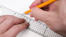 Drawing a line with a ruler and pencil.  stock video