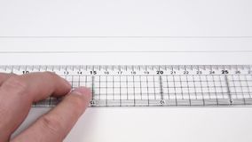 Drawing a line with a ruler and pencil.  stock video footage