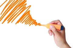 Drawing Line or tornado hurricane concept. Hand with orange marker drawing line isolated on white.It also can be tornado hurricane concept Stock Photo