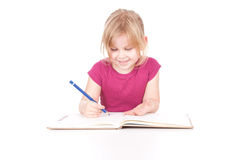 Drawing little girl with blue crayon Stock Photography